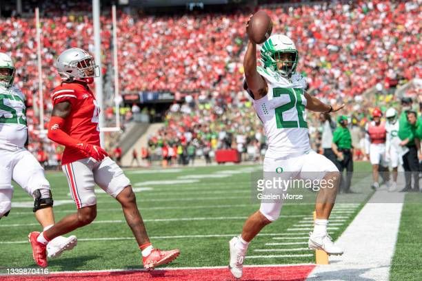 Running back Travis Dye of the Oregon Ducks scores a touch down during the 3rd quarter against the Ohio State Buckeyes at Ohio Stadium on September...