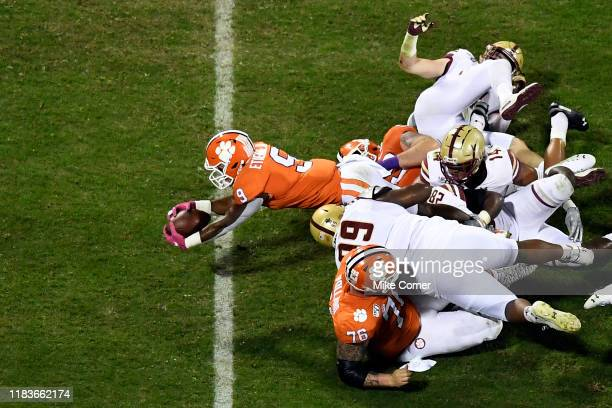 Running back Travis Etienne of the Clemson Tigers dives for a touchdown against the Boston College Eagles during the first quarter of their football...
