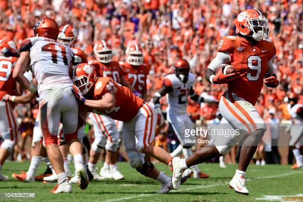 Running back Travis Etienne of the Clemson Tigers runs in the gamewinning touchdown against the Syracuse Orange during the fourth quarter of the...