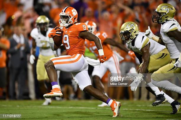 Running back Travis Etienne of the Clemson Tigers rushes for a touchdown during the second quarter of the Tigers' football game against the Georgia...