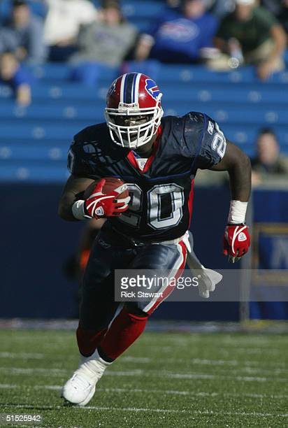 Running back Travis Henry of the Buffalo Bills carries the ball during the game with the New England Patriots on October 3, 2004 at Ralph Wilson...