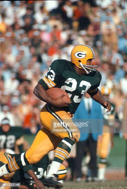 Running Back Travis Williams of the Green Bay Packers carries the ball during an NFL football game circa 1968 at Lambeau Field in Green Bay Wisconsin...