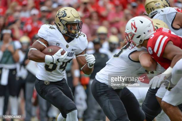 Running back Travon McMillian of the Colorado Buffaloes runs against the Nebraska Cornhuskers at Memorial Stadium on September 8 2018 in Lincoln...