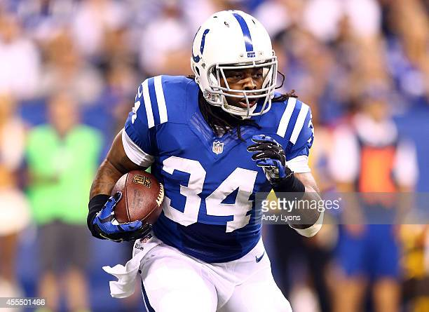 Running back Trent Richardson of the Indianapolis Colts carries the ball against the Philadelphia Eagles during a game at Lucas Oil Stadium on...