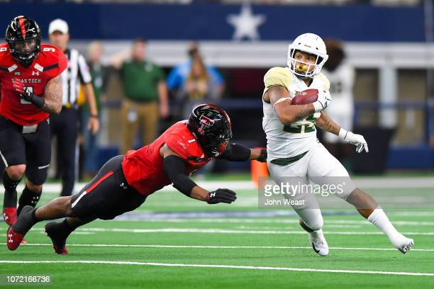 Running back Trestan Ebner of the Baylor Bears tries to get past linebacker Jordyn Brooks of the Texas Tech Red Raiders during the game on November...