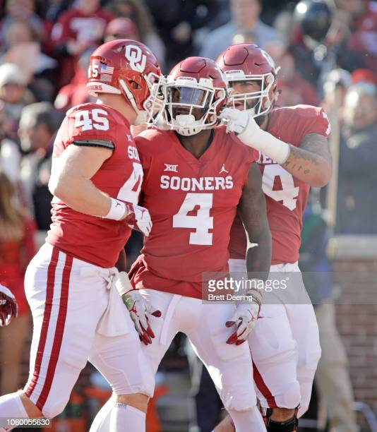 Running back Trey Sermon celebrates his touchdown with fullback Carson Meier and offensive lineman Cody Ford of the Oklahoma Sooners during the game...