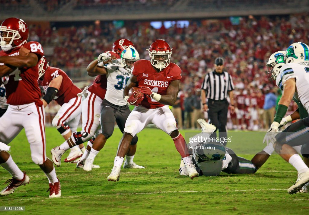 Running back Trey Sermon #4 of the Oklahoma Sooners looks for a hole against the Tulane Green Wave at Gaylord Family Oklahoma Memorial Stadium on September 16, 2017 in Norman, Oklahoma. Oklahoma defeated Tulane 56-14.