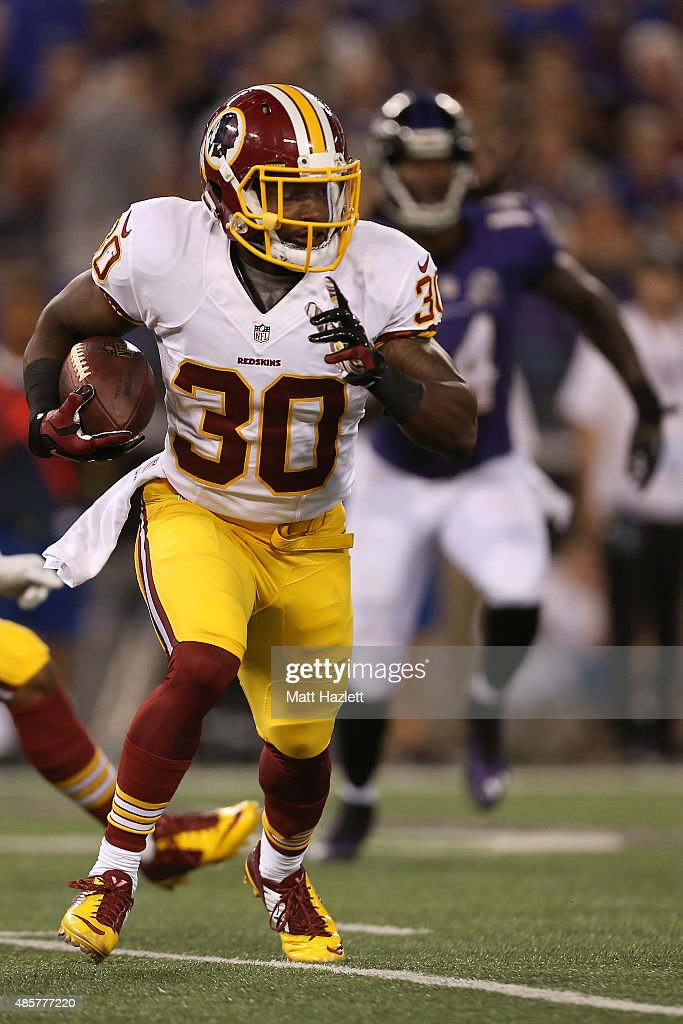 Running back Trey Williams #30 of the Washington Redskins carries the ball in the fourth quarter of a preseason game against the Baltimore Ravens at M&T Bank Stadium on August 29, 2015 in Baltimore, Maryland.