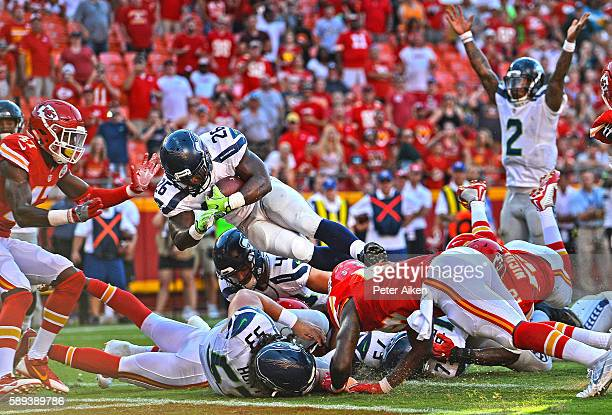 Running back Troymaine Pope of the Seattle Seahawks dives over the goal line for the game winning two point conversion against the Kansas City Chiefs...