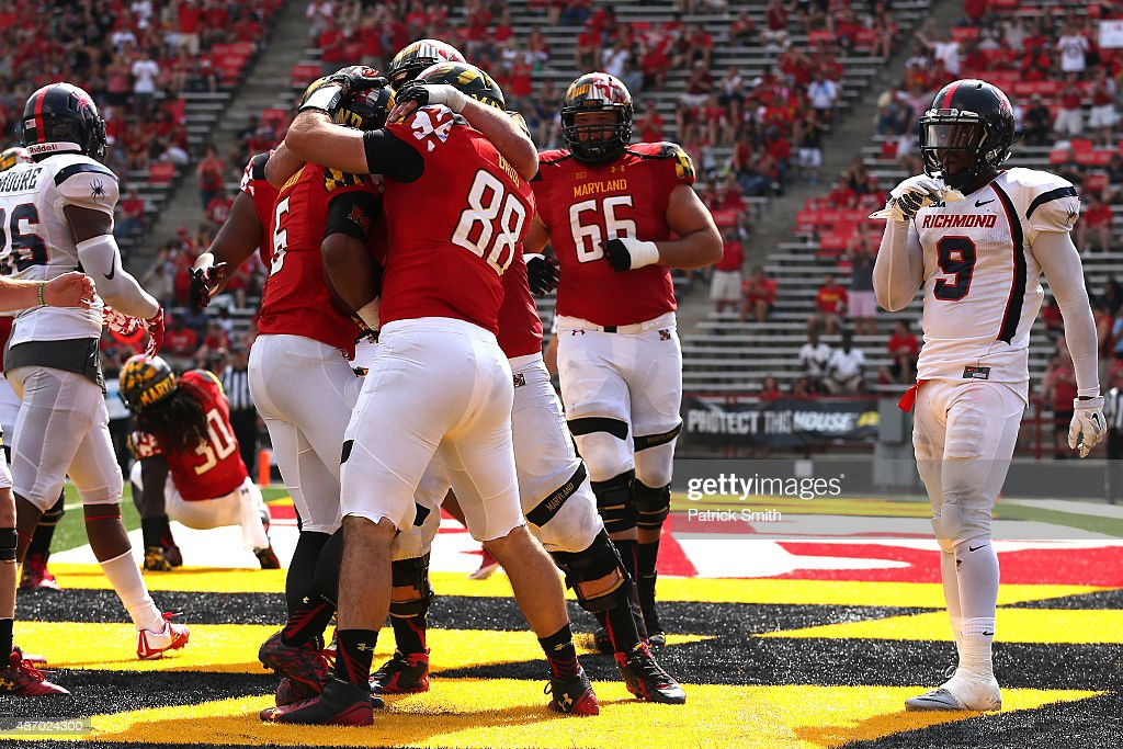 Running back Ty Johnson #6 of the Maryland Terrapins celebrates with teammates after scoring a touchdown in the fourth quarter against the Richmond Spiders at Byrd Stadium on September 5, 2015 in College Park, Maryland. The Maryland Terrapins won, 50-21.