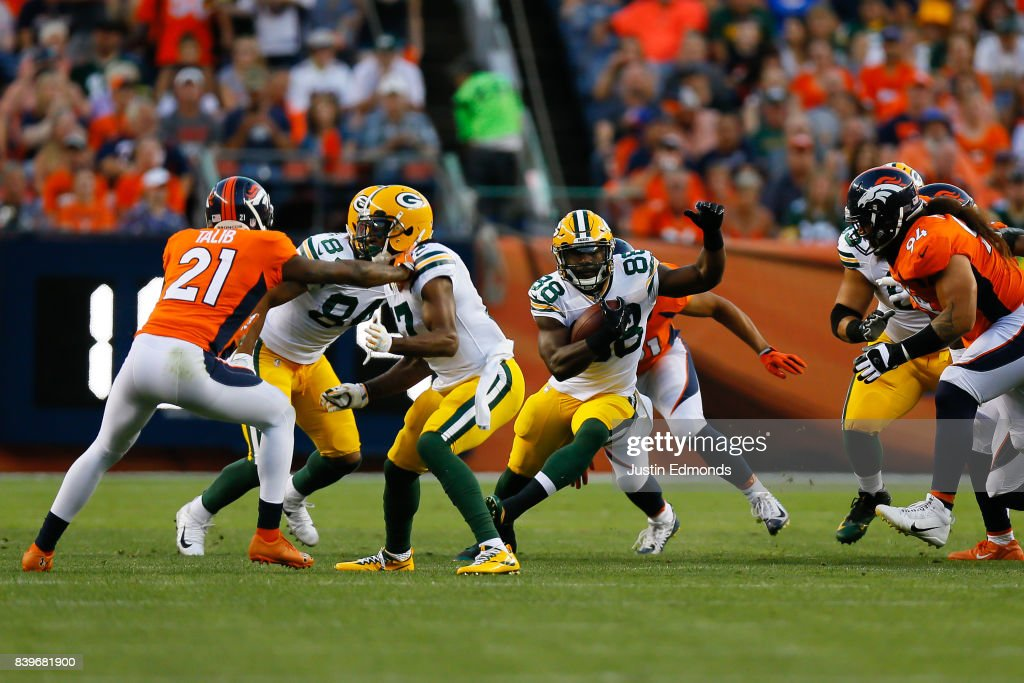 Running back Ty Montgomery #88 of the Green Bay Packers runs with the football in the first quarter during a Preseason game against the Denver Broncos at Sports Authority Field at Mile High on August 26, 2017 in Denver, Colorado.