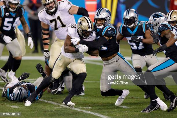 Running back Ty Montgomery of the New Orleans Saints attempts to gain yardage against safety Jeremy Chinn of the Carolina Panthers during the second...