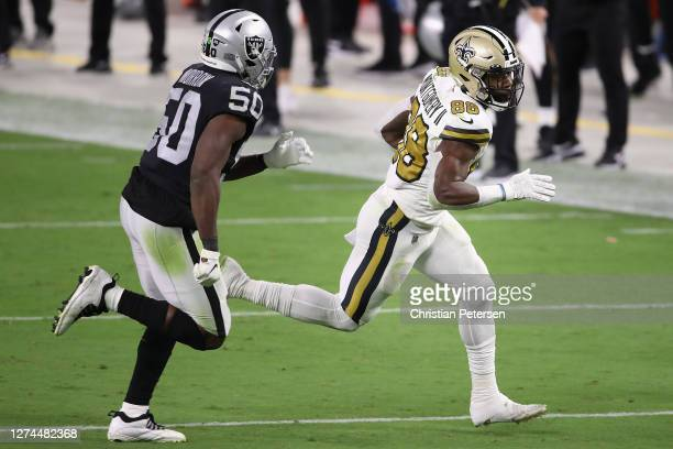 Running back Ty Montgomery of the New Orleans Saints runs with the football after a reception against linebacker Nicholas Morrow of the Las Vegas...