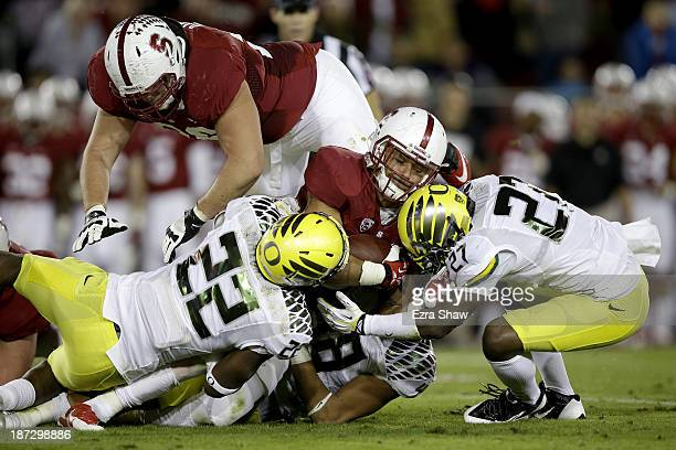 Running back Tyler Gaffney of the Stanford Cardinal runs the ball in the first half against linebacker Derrick Malone of the Oregon Ducks at Stanford...