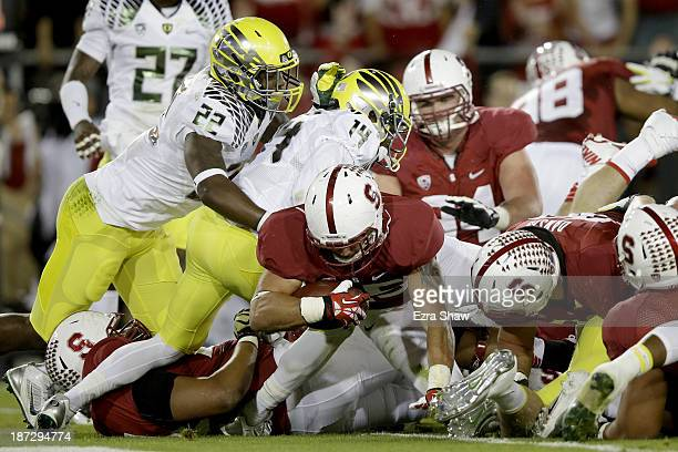 Running back Tyler Gaffney of the Stanford Cardinal scores a twoyard touchdown in the first quarter against the Oregon Ducks at Stanford Stadium on...
