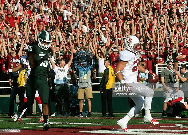 Running back Tyler Gaffney of the Stanford Cardinal scores on a 16yard run against the Michigan State Spartans in the first quarter of the 100th Rose...