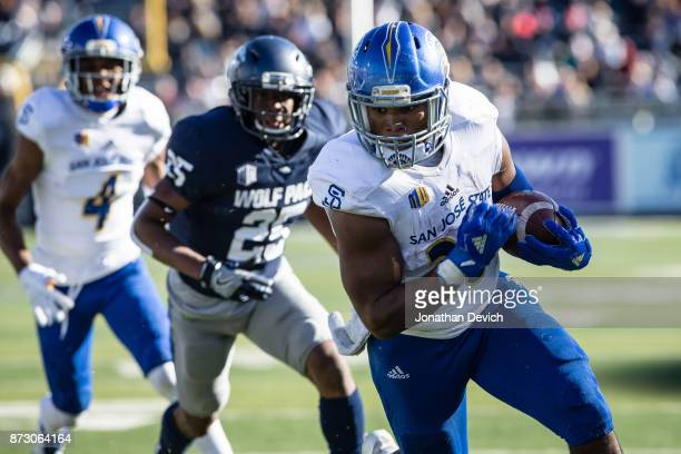 Running back Tyler Nevens of the San Jose State Spartans makes it past defensive back Daniel Brown of the Nevada Wolf Pack to score a touchdown at...