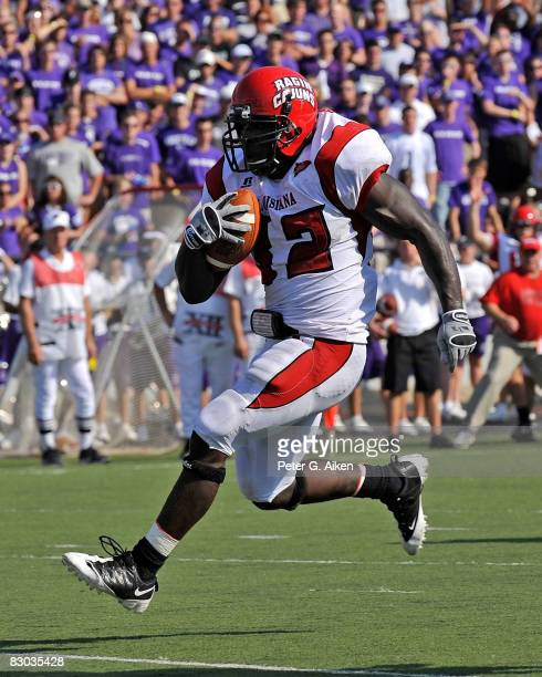 Running back Tyrell Fenroy of the Louisiana-Lafayette Ragin' Cajuns scores on a 15 yard touchdown run against the Kansas State Wildcats in the second...