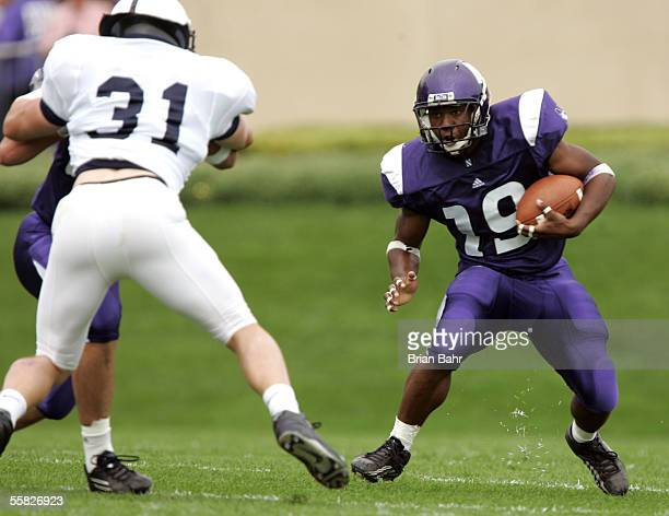 Running Back Tyrell Sutton of the Northwestern Wildcats runs with the ball against linebacker Paul Posluszny of the Penn State Nittany Lions...
