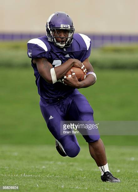 Running Back Tyrell Sutton of the Northwestern Wildcats runs with the ball against the Penn State Nittany Lions September 24, 2005 at Ryan Field in...