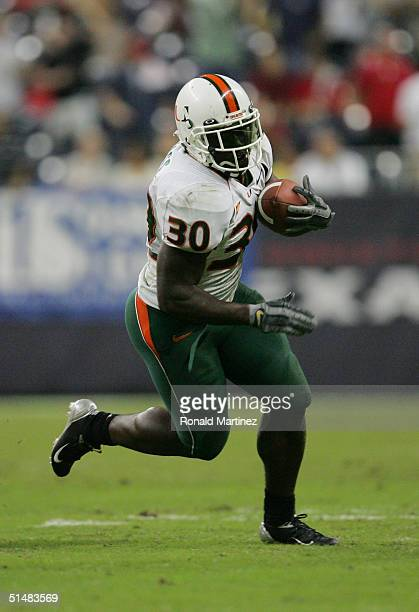 Running back Tyrone Moss of the University of Miami Hurricanes caries the ball during the game with the University of Houston Cougars on September 23...
