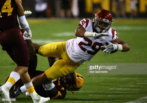 USC running back Vavae Malepeai dives out of bounds to stop the clock during the college football game between the USC Trojans and the Arizona State...