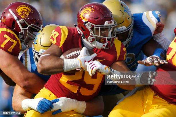 Running back Vavae Malepeai of the USC Trojans pushes through a tackle during the second half of a football game at Rose Bowl on November 17 2018 in...