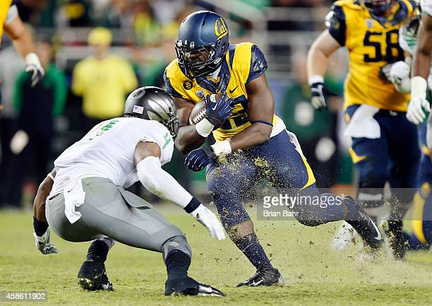 Running back Vic Enwere of the California Golden Bears carries the ball for 14 yards against safety Erick Dargan of the Oregon Ducks in the fourth...