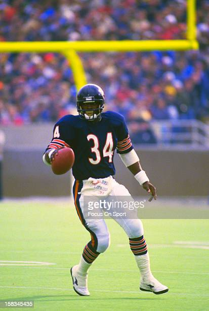 Running back Walter Payton of the Chicago Bears carries the ball during an NFL football game circa 1985 at Soldier Field in Chicago Illinois Payton...