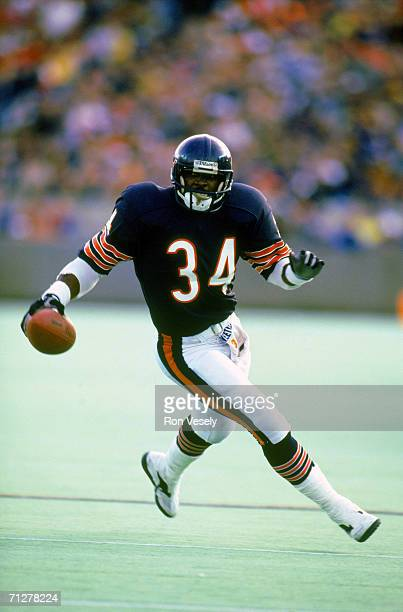 Running back Walter Payton of the Chicago Bears carries the ball in an undated photo at Soldier Field in Chicago, Illinois. Payton played for the...