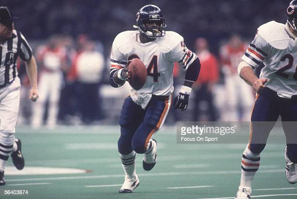 Running Back Walter Payton of the Chicago Bears carries the ball during Super Bowl XX against the New England Patriots on January 26 1986 at the...
