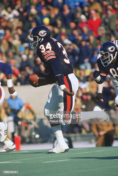 Running back Walter Payton of the Chicago Bears carries the ball against the Denver Broncos during an NFL football game December 20 1981 at Soldier...
