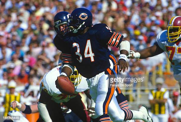 Running back Walter Payton of the Chicago Bears carries the ball against the Washington Redskins during an NFL football game September 29 1985 at...