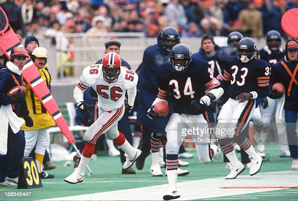 Running back Walter Payton of the Chicago Bears carries the ball against the Atlanta Falcons during an NFL football game November 24 1985 at Soldier...