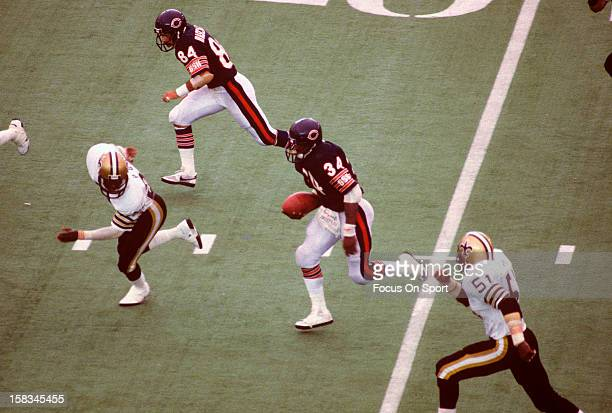 Running back Walter Payton of the Chicago Bears carries the ball against the New Orleans Saints during an NFL football game October 7 1984 at Soldier...