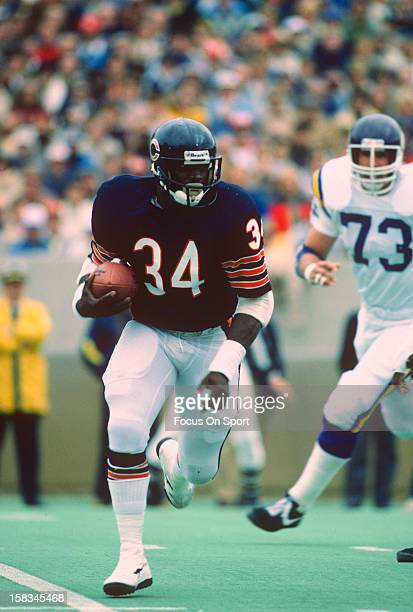 Running back Walter Payton of the Chicago Bears carries the ball against the Minnesota Vikings during an NFL football game October 9 1983 at Soldier...