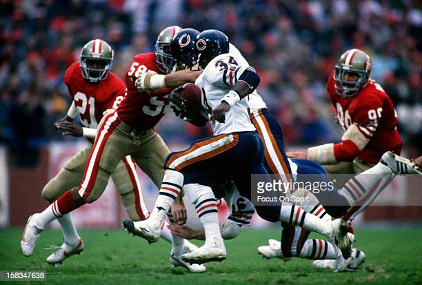 Running back Walter Payton of the Chicago Bears carries the ball against the San Francisco 49ers during the NFC/NFL Conference Championship game...