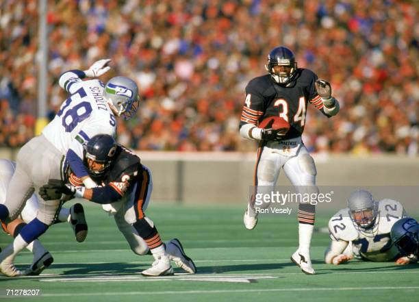 Running back Walter Payton of the Chicago Bears carries the ball against the Seattle Seahawks at Soldier Field on December 20 1987 in Chicago...