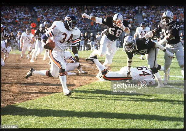 Running back Walter Payton of the Chicago Bears carries the ball against the Oakland Raiders during a preseason game at OaklandAlameda County...