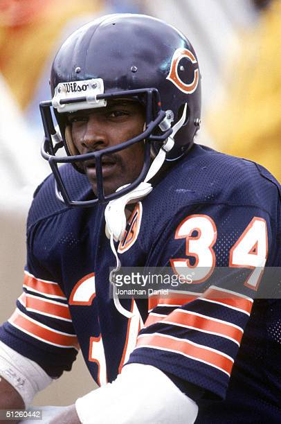 Running back Walter Payton of the Chicago Bears looks on during a game in 1983