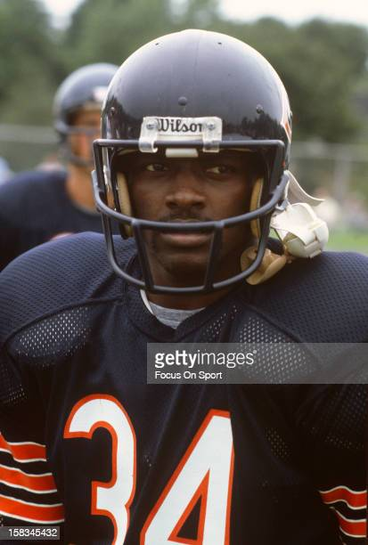 Running back Walter Payton of the Chicago Bears looks on during a Chicago Bears practice circa 1982 in Chicago Illinois Payton played for the Bears...