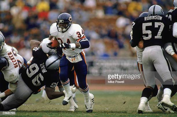 Running back Walter Payton of the Chicago Bears runs the ball during his final season game against the Los Angeles Raiders at the LA Coliseum on...