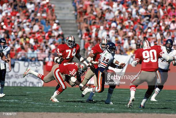 Running back Walter Payton of the Chicago Bears runs through the San Francisco 49ers defense during a game at Candlestick Park on October 13 1985 in...