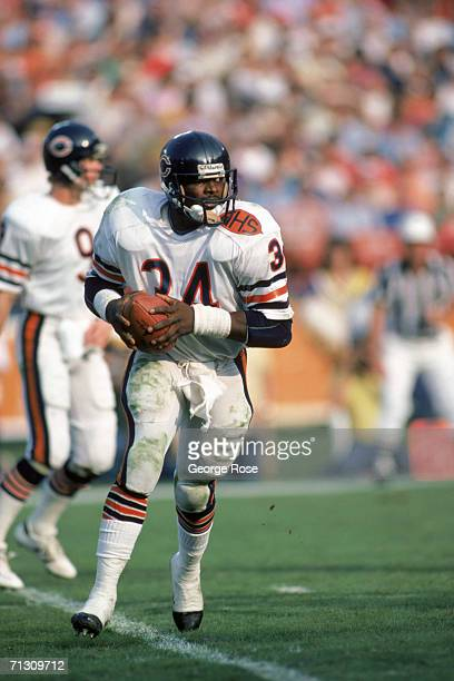Running back Walter Payton of the Chicago Bears runs with the ball during a game against the Los Angeles Rams at Anaheim Stadium on November 6 1983...