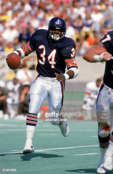 Running back Walter Payton of the Chicago Bears rushes for yards during a game circa 1975-1987 at Soldier Field in Chicago, Illinois.