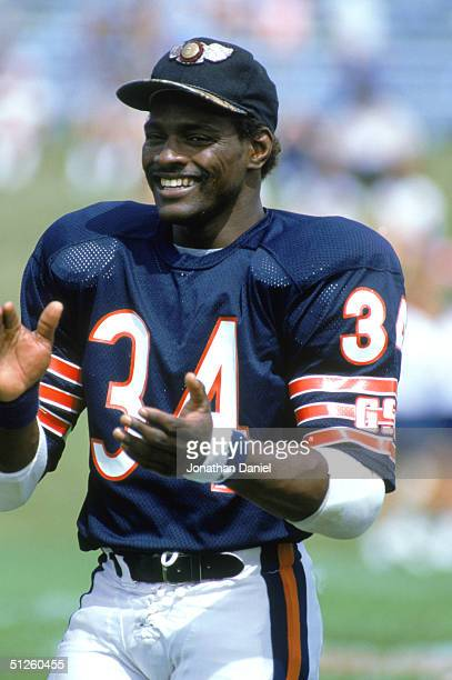 Running back Walter Payton of the Chicago Bears smiles during training camp in 1985.