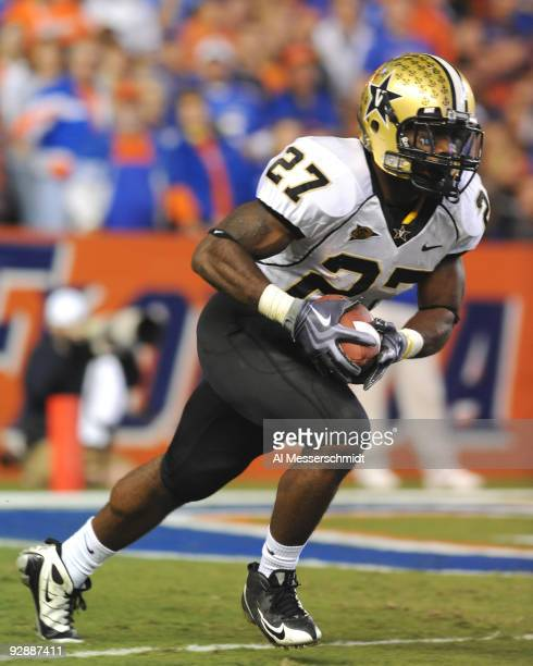 Running back Warren Norman of the Vanderbilt Commodores rushes upfield with a kick against the Florida Gators November 7, 2009 at Ben Hill Griffin...