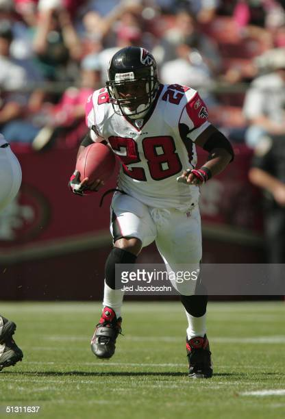 Running back Warrick Dunn of the Atlanta Falcons carries the ball during the game against the San Francisco 49ers at 3Com Park on September 12, 2004...