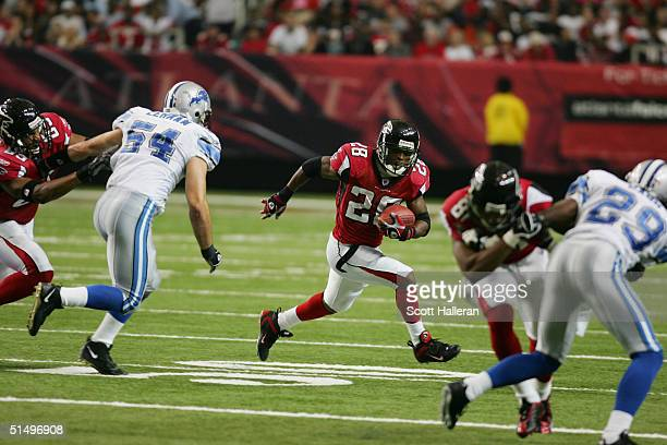 Running back Warrick Dunn of the Atlanta Falcons carries the ball during the game against the Detroit Lions at the Georgia Dome on October 10, 2004...