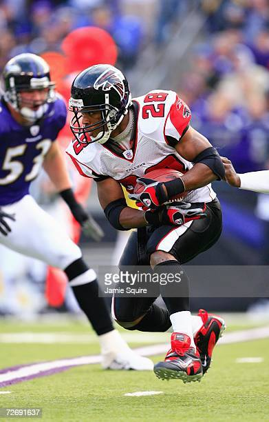 Running back Warrick Dunn of the Atlanta Falcons runs with the football during the game against the Baltimore Ravens at M&T Bank Stadium on November...